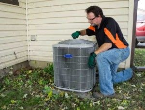 Technician working on an external HVAC unit